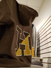 back of brown hoodie